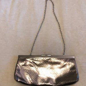 Women's Aldo clutch purse with a chain strap.